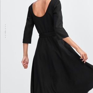 Dress with belt and buckle